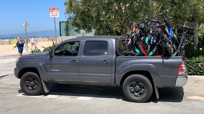 pickup truck with bed full of wheels bikes